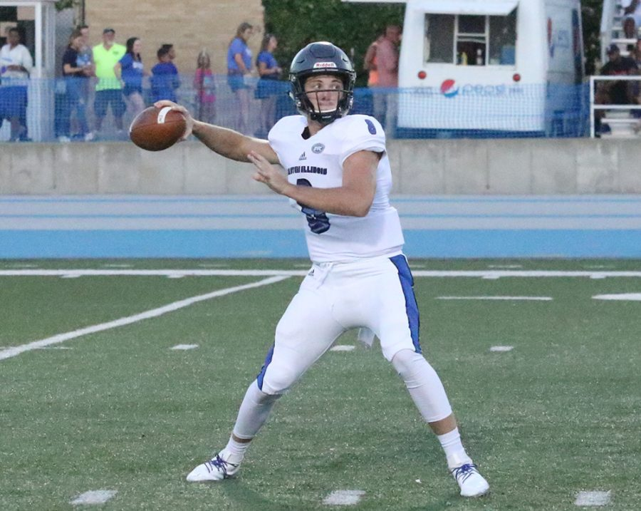 Eastern quarterback Harry Woodbery drops back to pass against Indiana State on Sept. 15. The Panthers lost the game 55-41.