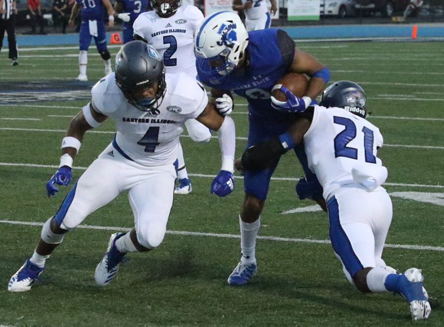 Eastern safety Raymond Crittenden (4) and cornerback Mark Williams (21) combine to make a tackle on an Indiana State ball carrier in a 55-41 loss in week three at O'Brien Field. The Eastern defense is ranked second-to-last in the OVC, ahead of just Tennessee Tech.