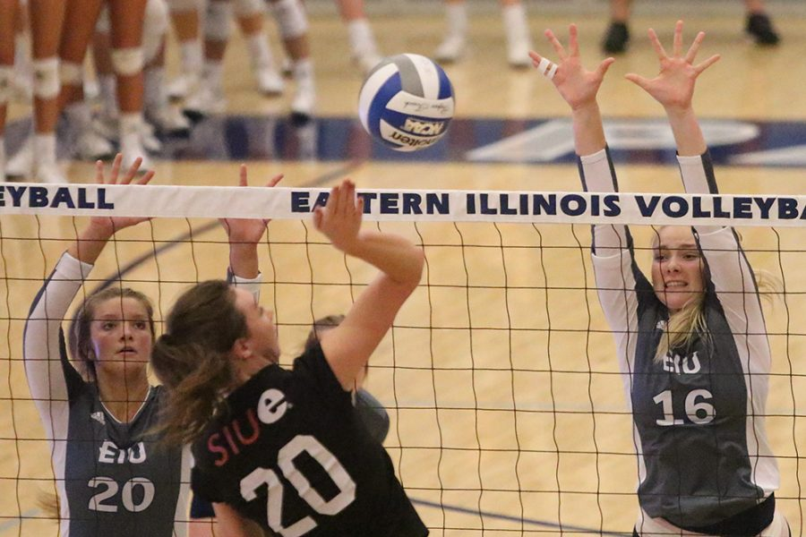 Eastern junior Maggie Runge jumps in the air to block a hit by a Southern Illinois Edwardsville player Sept. 19 at Lantz Arena. Eastern won the match three sets to zero.