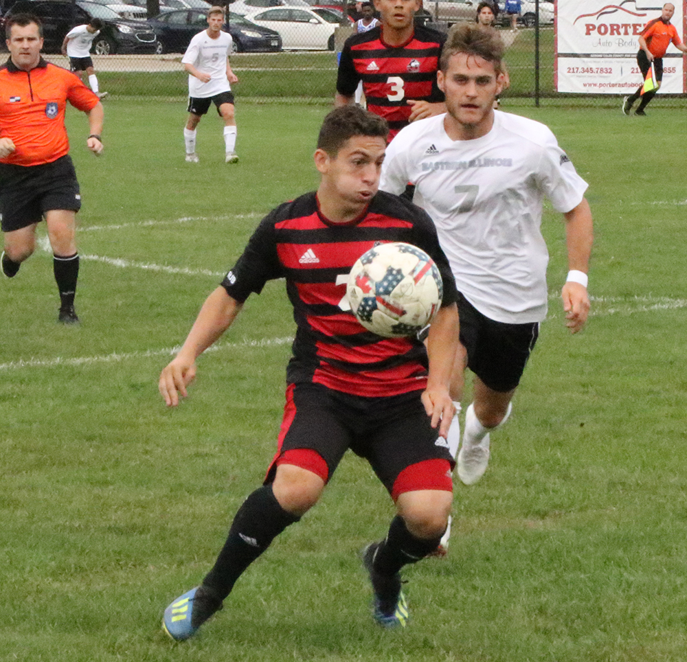 Eastern senior midfielder Jake Andrews closes in on a Northern Illinois player in a match on Sept. 21. The Panthers lost the match to the Huskies 2-0.