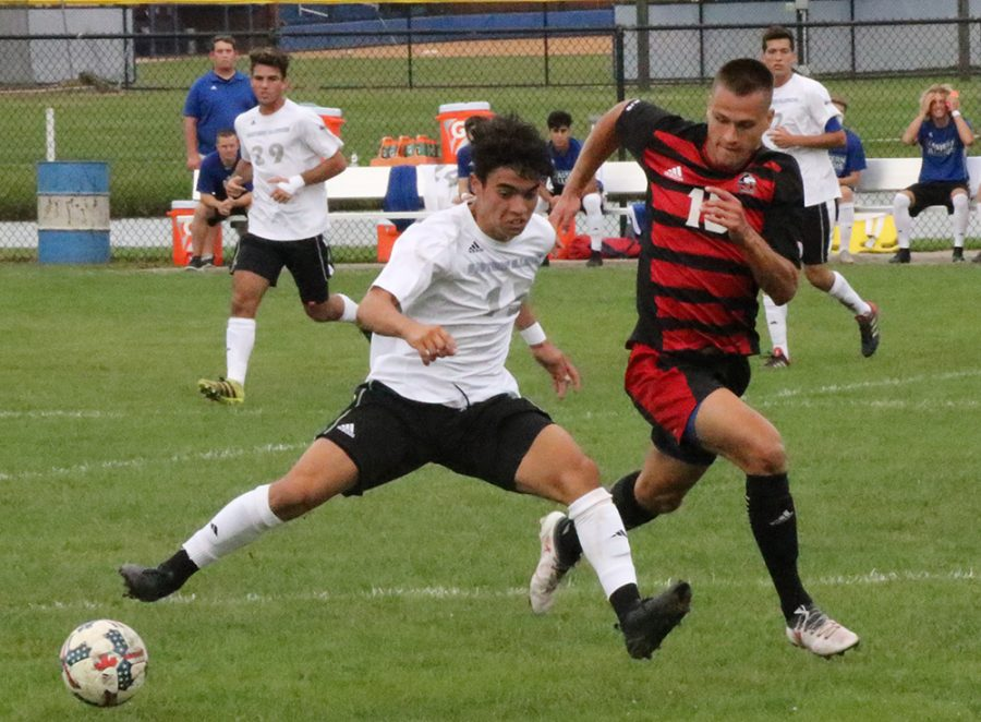 Eastern redshirt freshman Zabdiel Justiniano attempts to keep the ball in front of him in a match with Northern Illinois Sept. 21 at Lakeside Field. The Panthers lost the game 2-0 and saw their record fall to 2-4-2.