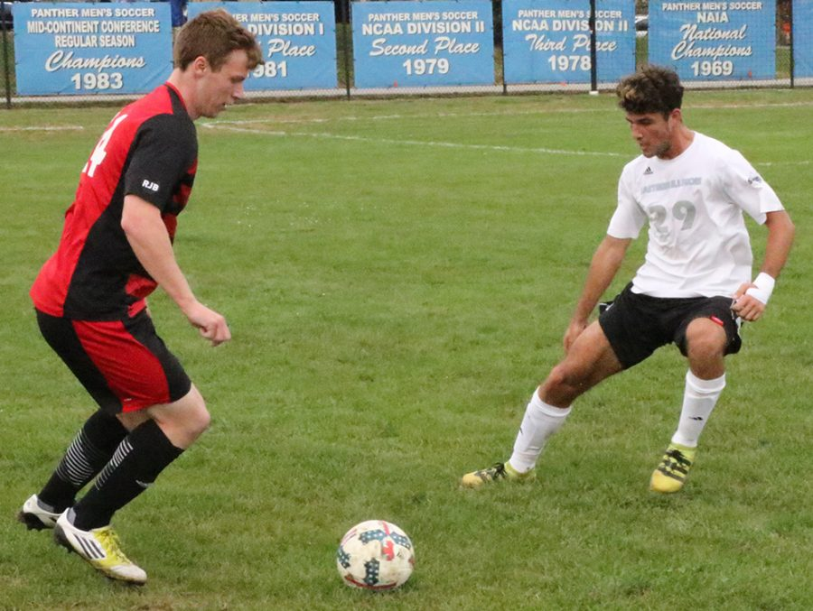 Eastern freshman Kevin Lenham guards a Northern Illinois player in the Panthers' 2-0 loss to the Huskies at Lakeside Field on Sept. 21.