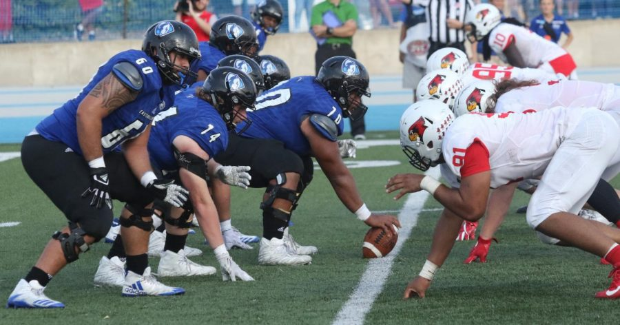 Eastern's offensive line lines up against Illinois State in the Panthers' 44-13 loss to the Redbirds at home last season. Illinois State and Eastern will play for the 107th time on Saturday in Bloomington.