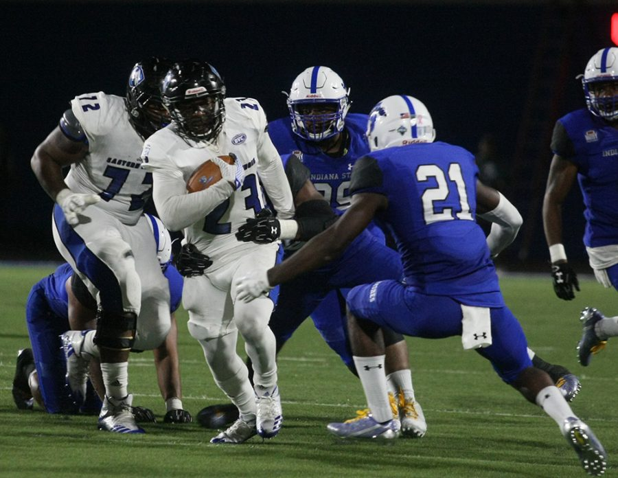 Eastern senior running back Isaiah Johnson crashes through Indina State's line in a road 22-20 road win last season. Johnson was one of three preseason all-conference selections for Eastern.