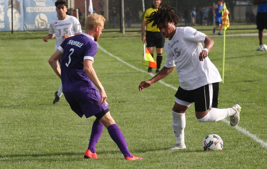 Eastern freshman Cole Stephens dribbles around an Evansville defender in the Panthers 1-1 draw with the Aces Aug. 31 at Lakeside Field. Eastern sits with a 1-1-1 record this season.