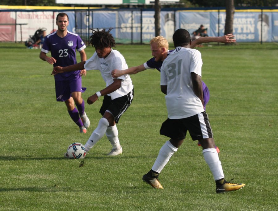 Eastern freshman Cole Stephens fights off an Evansville defender at Lakeside Field on Aug.31. The game ended in a 1-1 draw, Eastern is 2-3-2 this season.