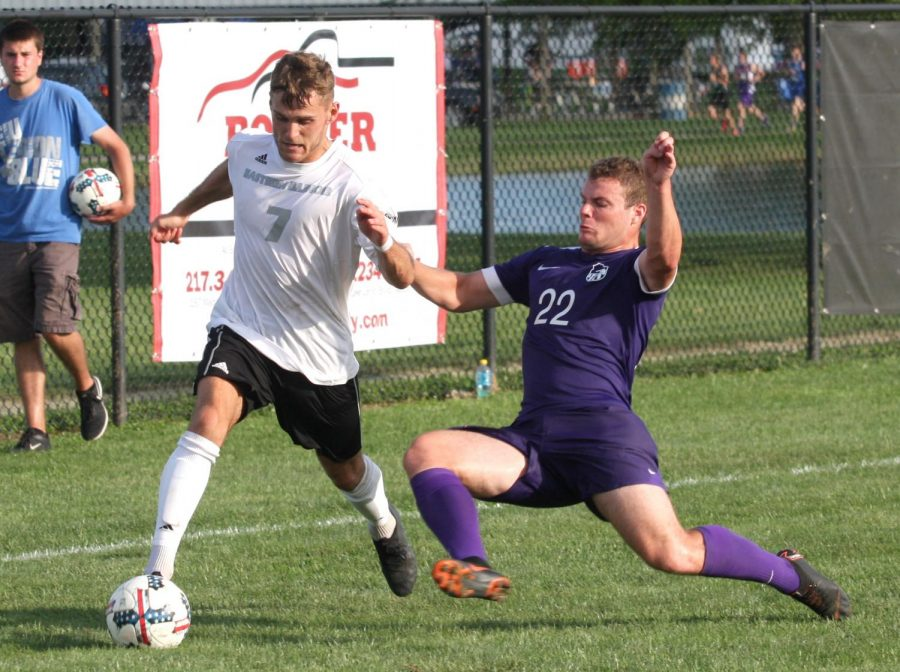 Eastern senior Jake Andrews tries to keep the ball away from an Evansville defender Aug. 31 at Lakeside Field. The Panthers tied with Evansville 1-1 in the game.