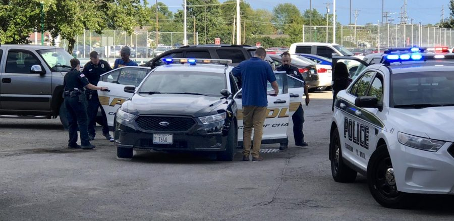A+man+was+arrested+in+the+parking+lot+of+Andrews+Hall+Thursday+afternooon+in+connection+to+a+stolen+car.+He+was+with+two+Eastern+students+at+the+time+of+his+arrest.
