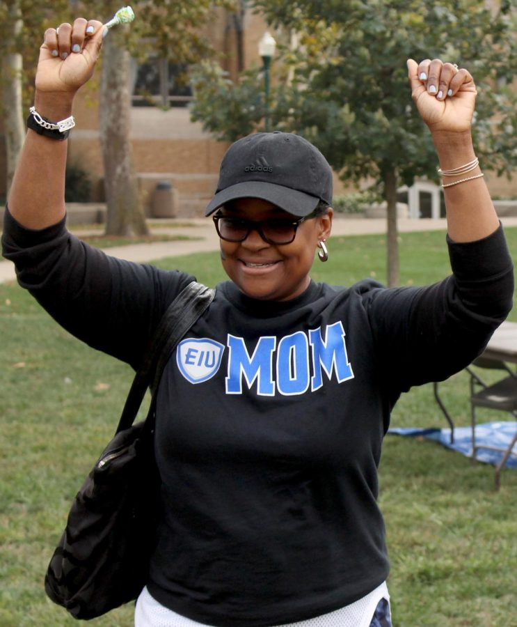 """Lashonda Banks celebrates her win at balloon darts at the RHA Family Carnival. Banks was visiting her son Jeremy Banks for Family Weekend. """"Family Weekend is very important to us because we still get to be together with (Jeremy) who is now apart from us,"""" Banks said."""
