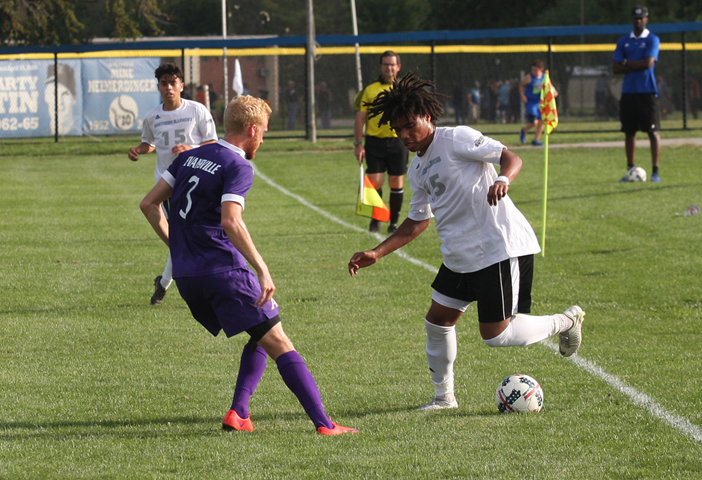 Freshman Cole Stephens tries to do a move with the ball to get around an Evansville defender during Eastern's 1-1 draw with Evansville at Lakeside Field on Aug. 31.