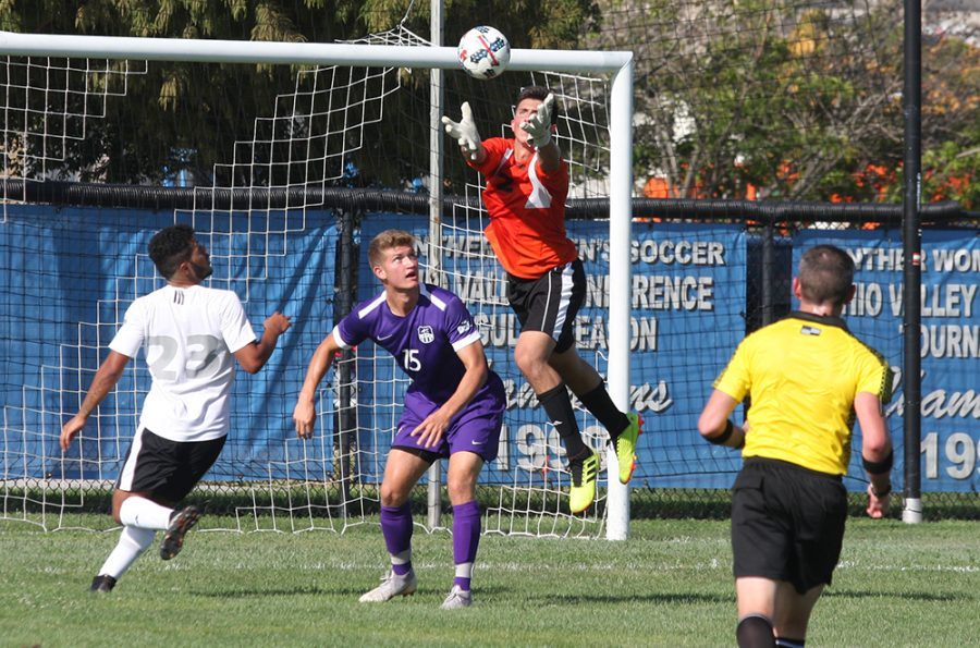Eastern goalkeeper Jonathan Burke jumps to save a crossed ball as an Evansville attacker positions himself to try and win the ball during Eastern's 1-1 tie on Aug. 31 at Lakeside Field.