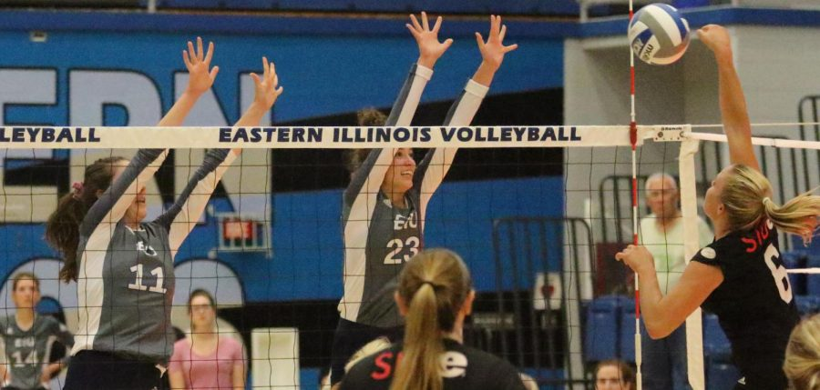 Eastern players Abby Knight (left) and Kylie Michael both attempt a block against Southern Illinois Edwardsville on Sept. 19, a 3-0 Eastern win.