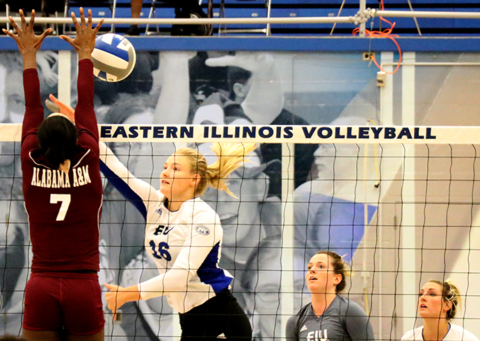 Junior+middle+hitter+Maggie+Runge+tries+to+spike+the+ball+as+an+Alabama+A%26amp%3BM+player+tries+to+block+it+during+the+EIU+Panther+Classic+in+Lantz+Arena+in+September+2017.