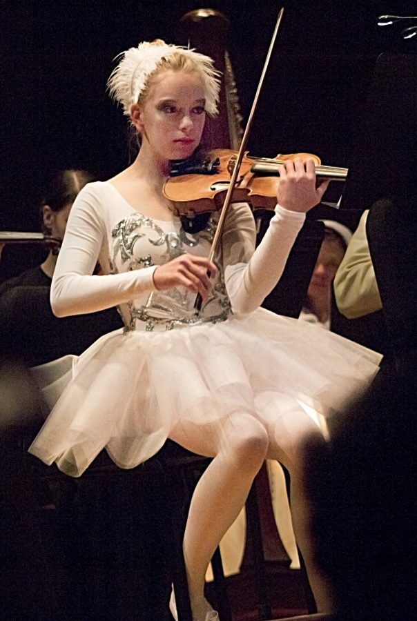 "Sadie Armstrong plays the violin in her handmade Swan Lake costume. ""I was like 'What am I going to be?'"" Armstrong said. ""Then we were playing (Swan Lake) so I was like 'Oh I'll just do that."""