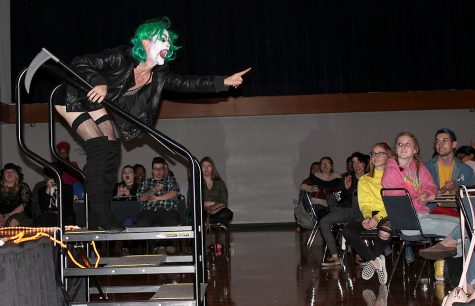 "Mother Natwhore, a performer in the student drag show and co-host for the event, laughs as a part of his performance Tuesday night in the Grand Ballroom. He ""died"" during the show and came back to life for a second and third performance."