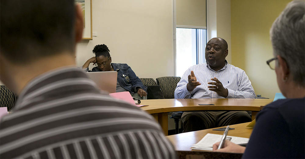 Mutombo Kabasele is the associate dean of the office of international students and scholars. He updated the Faculty Senate on international student enrollment and the process it takes to get them to Eastern.