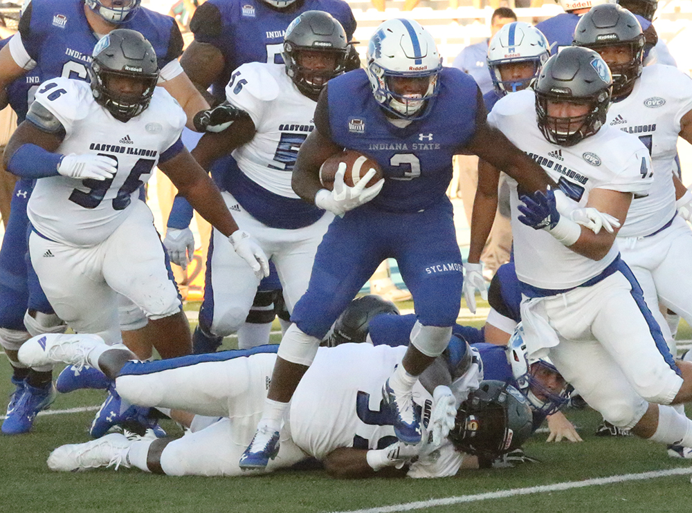 Indiana State running back ja'Quan Keys runs through a tackle attempt by Levi Watson (99) as linebacker Joe Caputo (45) runs in to bring him down. The defense for Eastern has been a focal point all season, and this week against Murray State the unit hopes to play well for all four quarters.