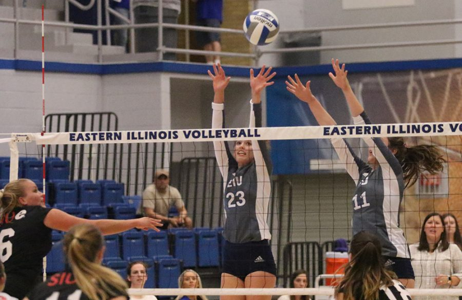 Eastern redshirt-freshman Kylie Michael (23) and senior Abby Knight (11) jump up to block a shot by a Southern Illinois Edwardsville player on Sept. Lantz Arena. The Panthers won the match 3-0 and currently hold a record of 7-16.