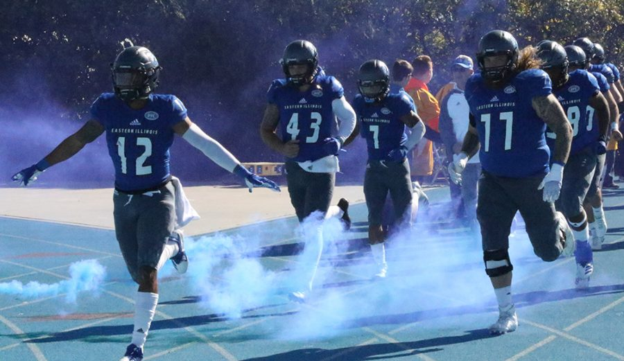 Eastern defensive back DySaun Smith (12) leads his team out of the tunnel prior to Eastern's 24-21 overtime win over Tennessee-Martin on Saturday. Eastern now stands at 2-2 in conference play.