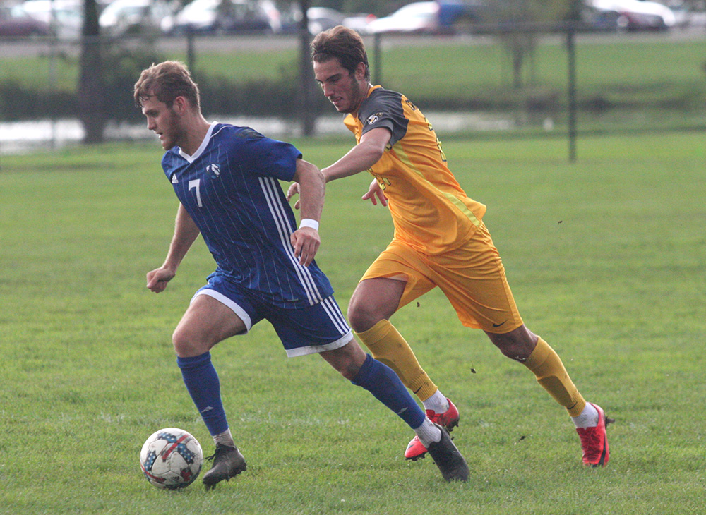 Eastern senior Jake Andrews keeps the ball away from a Valparaiso defender in the Panthers 2-1 loss Wednesday at Lakeside Field.