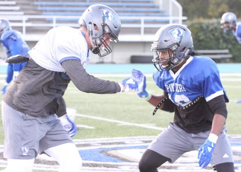 Eastern cornerback Javon Turner plays press coverage on a teammate in practice Wednesday at O'Brien Field. Turner is a converted wide receiver now playing defensive back for the Panthers.