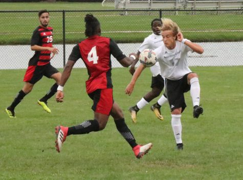 Cameron Behm gets ready to settle the ball with teammate Kris Luke running behind him and a Northern Illinois defender running toward him during a 2-0 loss on Sept. 21 at Lakeside Field.