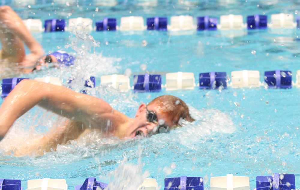 Sophomore Christopher Dixon competes in the distance freestyle event against Saint Louis on Oct. 19 at the Padovan Pool. Dixon finished second in the event.