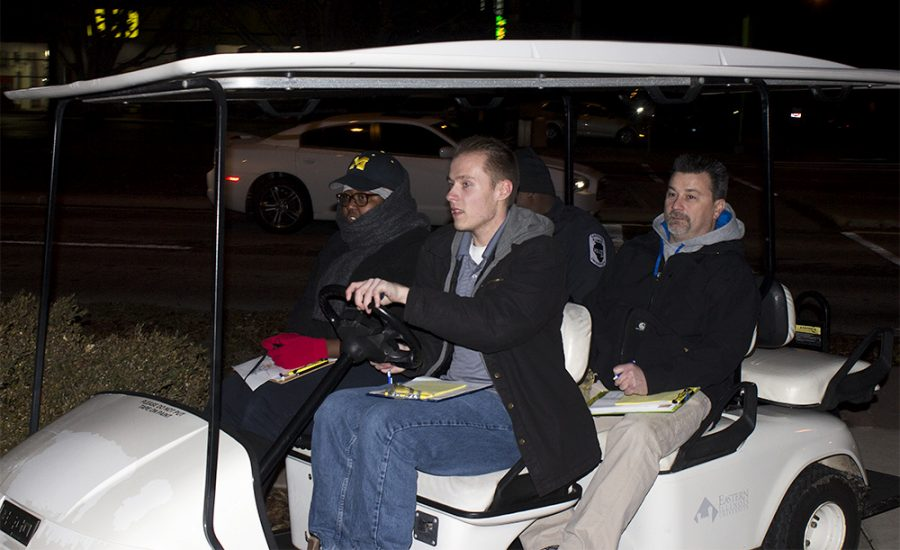 Seth Yeakel, a mathematics major, drives group two in a golf cart during the Safety Walk Monday night outside of Old Main.