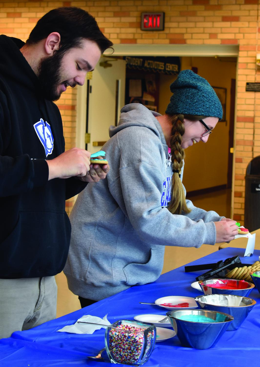 Zac Cohen, the executive vice president of Student Senate, and Rebecca Cash, the student body president, decorate cookies Tuesday afternoon at the Bridge Lounge of the Martin Luther King Jr. University Union.