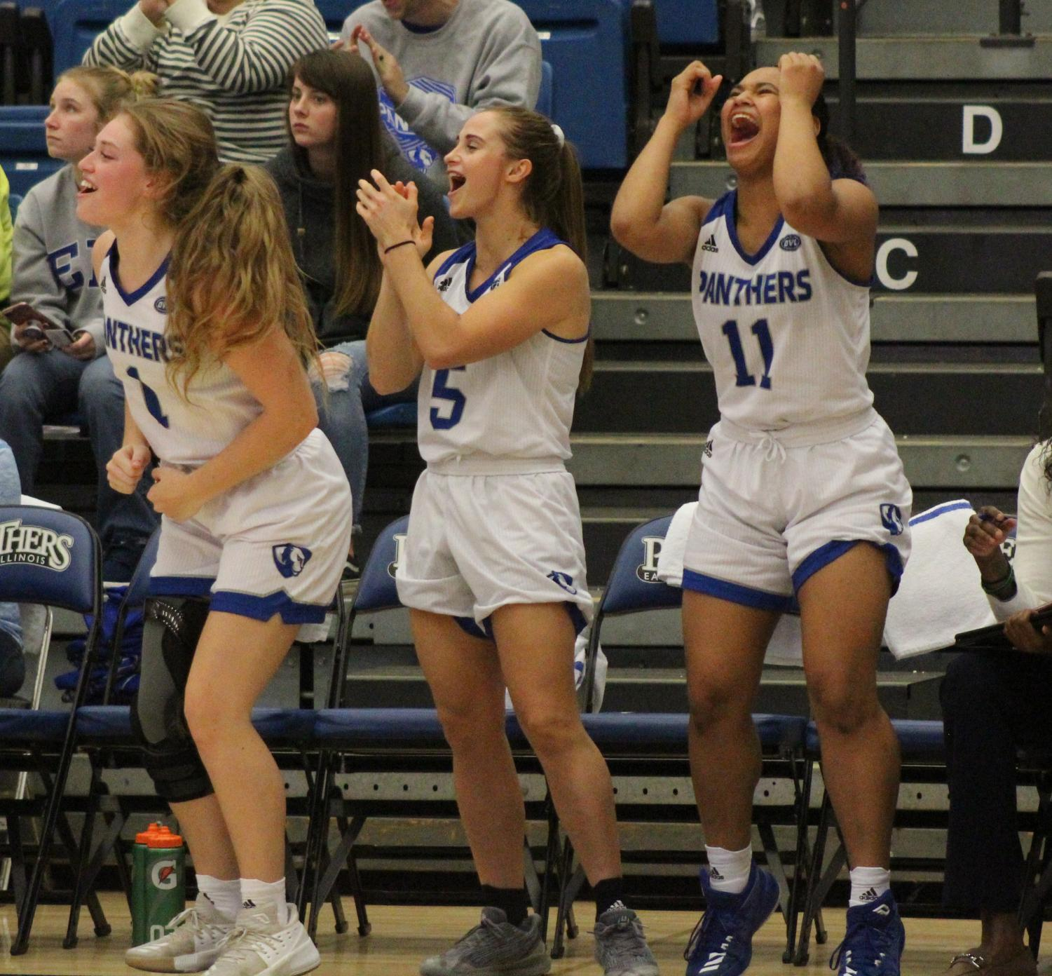 Eastern basketball players (from left) Kira Arthofer, Grace Lennox and Karle Pace celebrate the Panthers breaking the 100-point mark late in the game on Nov. 6 against Oakland City. It was the first time since 2009 the Panthers reached 100 points.