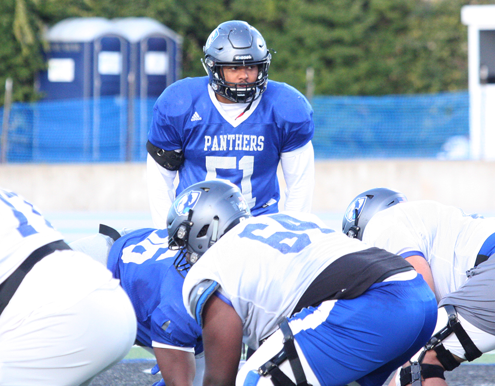 Eastern sophomore linebacker Dytarious Johnson looms over the defensive line as he prepares to defend in a practice at O'Brien Field in October. Johnson is second on the team with 60 tackles and first with 12 tackles for loss.