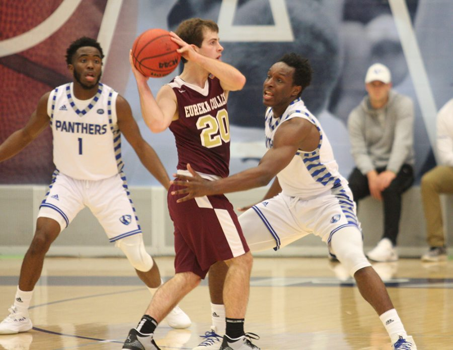 Eastern+sophomore+guard+Mack+Smith+plays+defense+on+a+Eureka+College+ball+handler+in+the+Panthers%E2%80%99+74-44+win+on+Friday+night+in+exhibition+play.+Smith+had+11+on+4-of-9+shooting+in+the+game+at+Lantz+Arena.