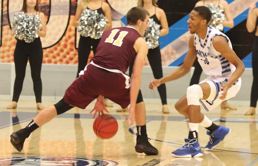Eastern+freshman+Cam+Burrell+plays+defense+on+an+opponent+from+Eureka+College+in+a+79-44+on+Nov.+2.+Burrell+has+played+in+just+two+games+this+season+for+the+Panthers.