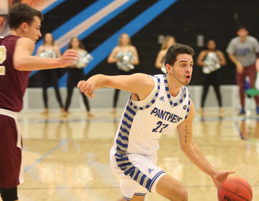 Eastern sophomore guard Josiah Wallace drives the basket in the Panthers 79-44 exhibition win over Eureka on Nov. 2. Eastern is 0-2 this season and play Western Illinois Saturday in Lantz Arena.