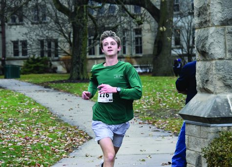 Noah Oakley, a junior at Charleston High School, was the first person to cross the finish line during this year's Holiday Hustle on Saturday in front of Old Main. He finished with a time of 18 minutes and 49 seconds and said even though the race helped him train for the next track and cross country season, he felt like he contributed to a good cause.