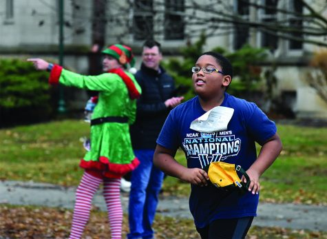 10-year-old Keagan Baah of Oakland races to the finish line Saturday during the Holiday Hustle 5K run/walk.