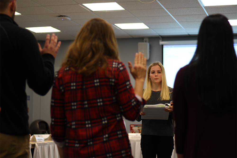 Alicia Matusiak, the Student Vice President of Student Affairs, swears in the new student deans at Wednesday night's student senate meeting in the Arcola-Tuscola room of the Martin Luther King Jr. University Union.