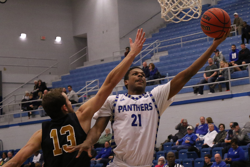 Eastern junior Braxton Shaw leaps for a layup in Eastern's 104-60 loss to Fort Wayne on Nov. 28. Eastern lost its thirs game in a row Saturday against Chicago State 80-72.