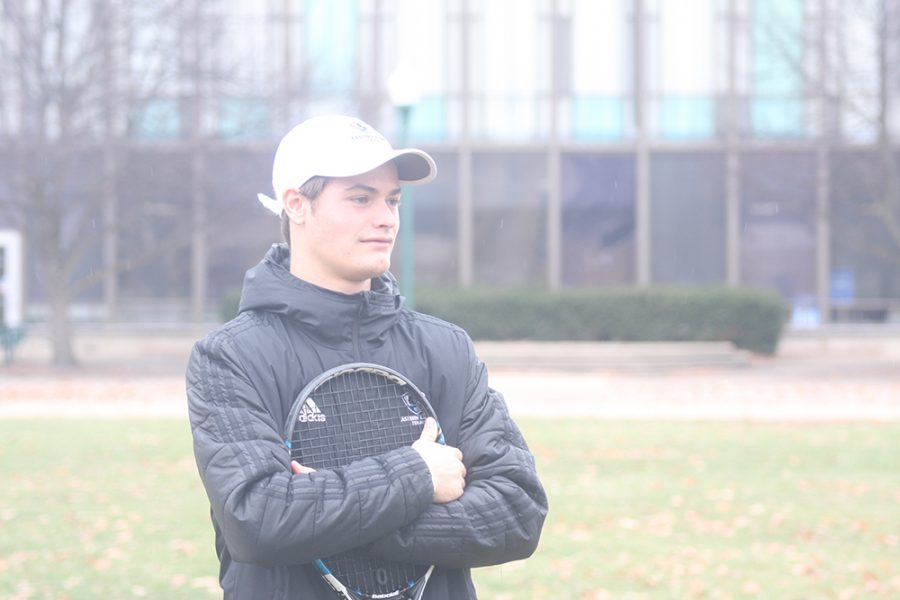 Sophomore+Mike+Jansen+stands+in+the+quad+at+Eastern+holding+his+tennis+racket.+Jansen+is+from+the+Netherlands+he+was+ranked+in+the+top+20+in+the+Netherlands+for+juniors+18+and+younger.
