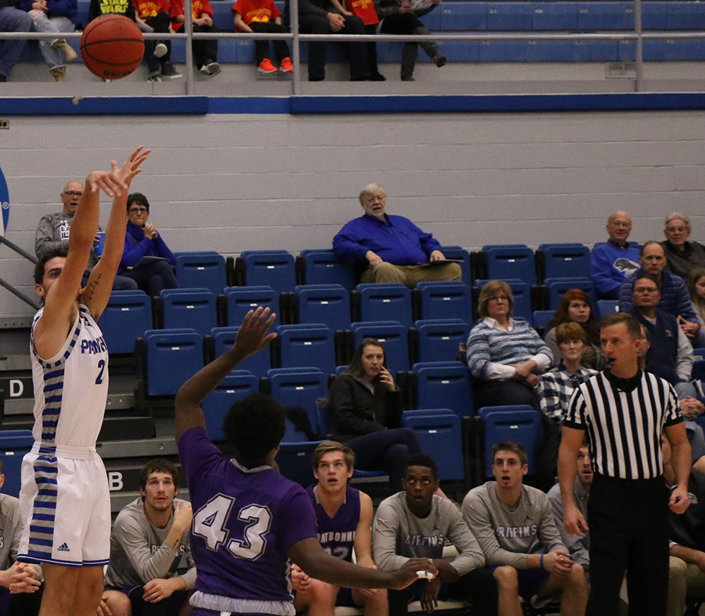 Josiah Wallace shoots a three-pointer from the corner during the Panthers' 90-37 rout of Fontbonne University in Lantz Arena Tuesday night.