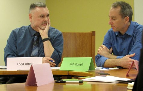Todd Bruns, the Faculty Senate chair, talks with Jeffery Stowell, the Faculty Senate vice chair during a meeting Tuesday afternoon in room 4400 of Booth Library.