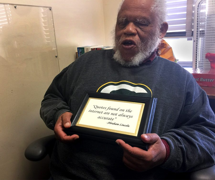 "Martin Hardeman, a history professor, holds a plaque he received as a gift over winter break. The plaque says, ""Quotes found on the internet are not always accurate- Abraham Lincoln."" He said he thought it fit perfectly in his office, and students can learn a lot from it."