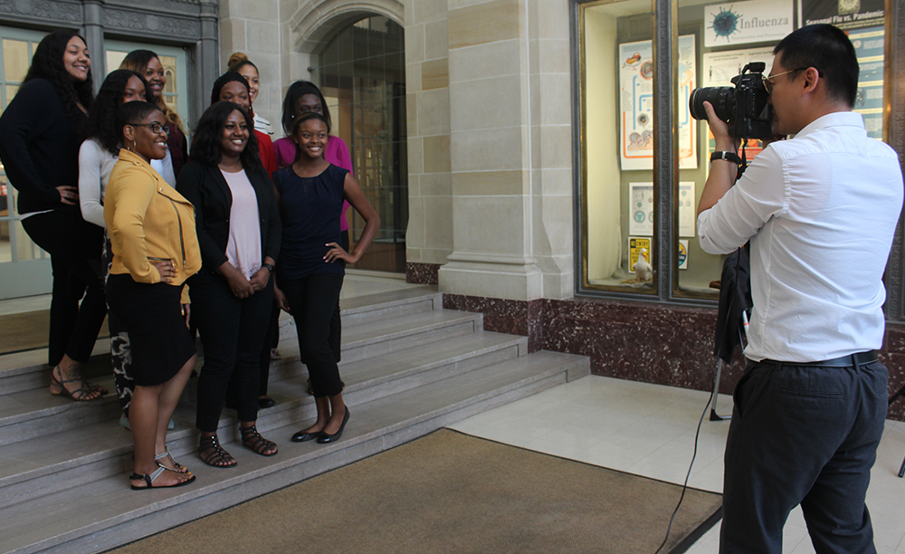 Warbler Photo Editor Qian Cheng (Fall 2018) takes a picture of the National Association of Colored Women's Clubs Inc. for the Warbler Yearbook in Booth Library in October.