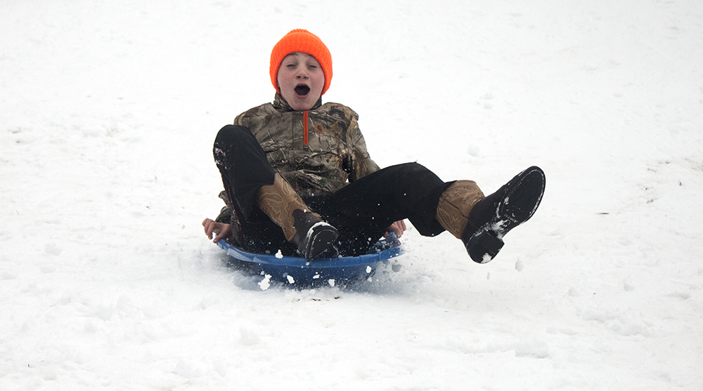 Charleston resident Cayden Hayes, 10, sleds down one of the two hills at Kiwanis Park Sunday afternoon. Hayes said he was going
