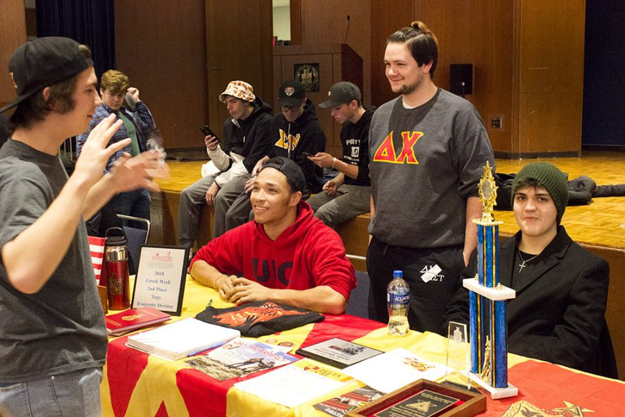 Students talk at the Delta Chi table Wednesday afternoon at Pantherpalooza in the University Ballroom.