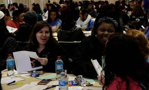 Volunteers put together recipe books for the Charleston Food Pantry at the Martin Luther King Jr.  Day of Service Monday afternoon in the University Ballroom.