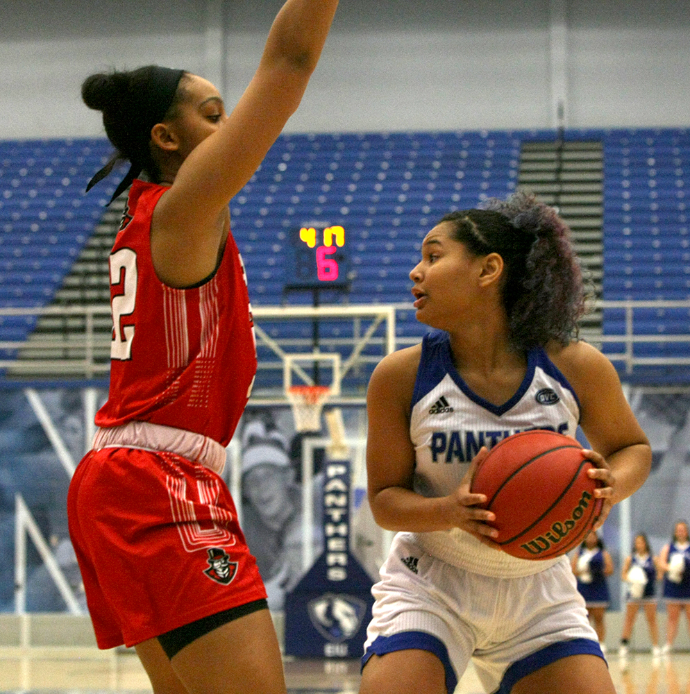 Eastern guard Karle Pace works around an Austin Peay defender in the Panthers' 73-60 loss to the Governors Saturday in Lantz Arena. Eastern plays Tennessee-Martin on the road Thursday.