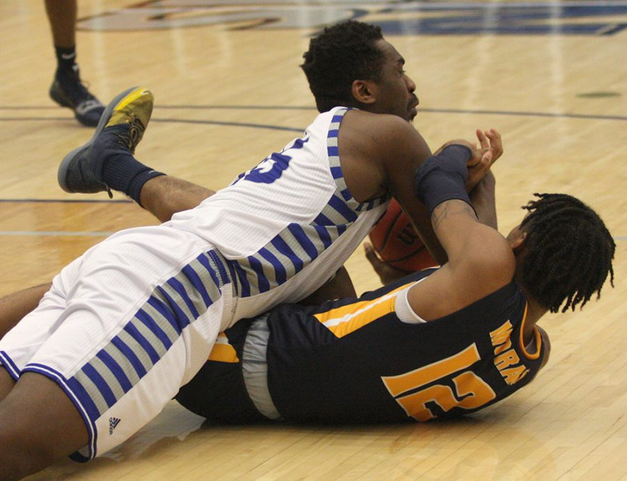 Eastern's Aboubacar Diallo fights with Murray State's Ja Morant for a loss ball last Jan. 17 in Lantz Arena. Eastern is 4-2 in the OVC in third place behind Murray State and Jacksonville State.