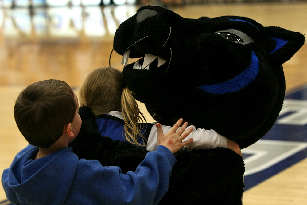Billy the Panther, hugs some children that ran up to him after the women's basketball game Saturday afternoon at Lantz Arena. The Panthers lost to the Austin Peay Governors 73-60.