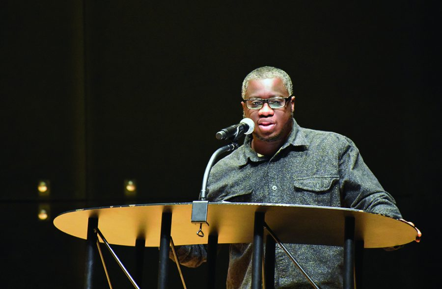 Rion Amilcar Scott, a fiction writer, reads an excerpt from his writing during the Lions in Winter Literary Festival Saturday in the Doudna Recital Hall of Doudna Fine Arts Center.